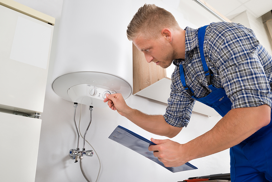 man checking the water heater